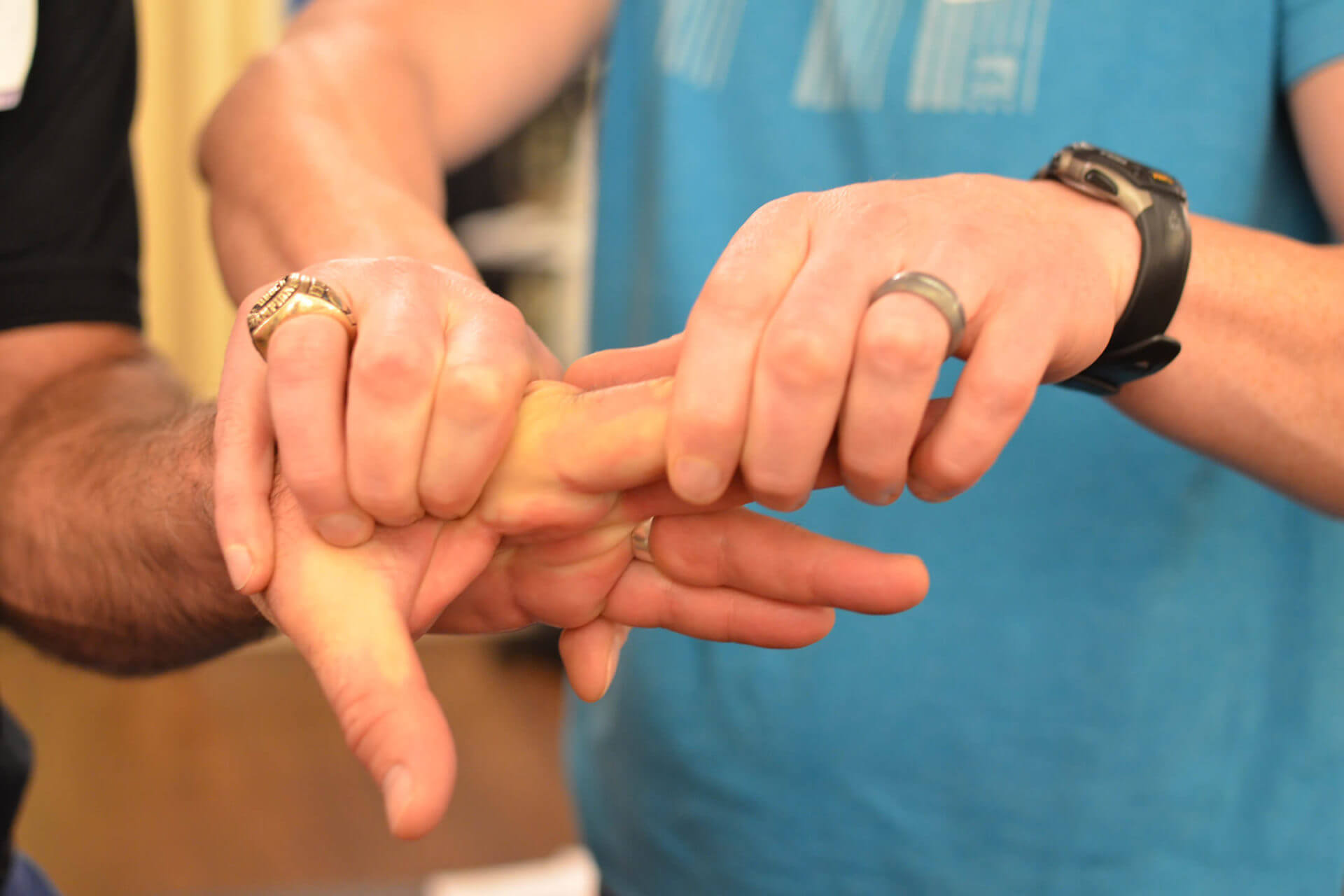 ART provider performing hand treatment on patient