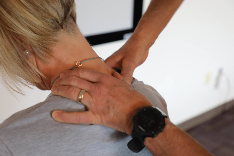 Practitioner working on a patient's shoulder